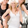 Fitness young girls spinning at gym posing — Stock Photo