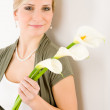 Romantic woman hold calla lily flower — Stock Photo