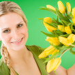 Young happy woman hold yellow tulips flower — Stock Photo