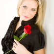 Elegant blond woman hold red rose — Stock Photo