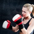 Stock Photo: Boxing training woman with punching bag in gym