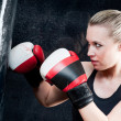 Boxing training woman with punching bag in gym — Stock Photo #6129778