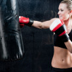 Boxing training woman punching bag in gym — Stock Photo