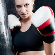 Boxing training woman with gloves in gym — Stock Photo #6129802