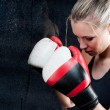 Boxing training woman with punching bag in gym - Stock Photo