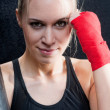 Boxing training blond woman sparring punching bag — Stock Photo