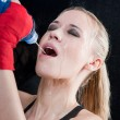 Boxing training woman pour water in her mouth — Stock Photo