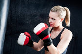 Boxing training woman with punching bag in gym — Stock Photo