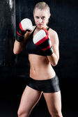 Sexy boxing training woman with gloves in gym — Stock Photo
