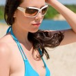 Stock Photo: Summer beach woman in blue bikini bra