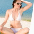 Young sexy bikini model relaxing with sunglasses — Stock Photo #6138289