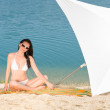 Young sexy bikini model relaxing with sunglasses — Stock Photo #6138310