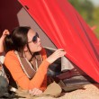 Camping happy woman in tent on beach — Stock Photo