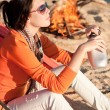 Camping happy woman by campfire on beach — Stock Photo #6138443
