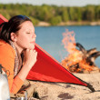 Camping happy woman relax in tent by campfire — Stock Photo #6138447