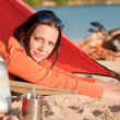 Camping happy woman in tent by campfire — Stock Photo #6138456