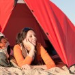 Camping happy woman relax tent on beach — Stock Photo