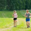 Royalty-Free Stock Photo: Sportive young couple jogging meadows sunny summer