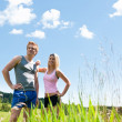 Sportive happy couple in meadows sunny day — Stock Photo #6138489