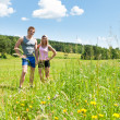 Royalty-Free Stock Photo: Sportive happy couple in meadows sunny day