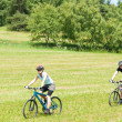 Sport happy couple riding bicycles in coutryside — Stock Photo #6138515