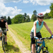 Sport happy couple riding bicycles in coutryside — Stock Photo #6138521