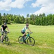Sport happy couple riding bicycles in coutryside — Stock Photo #6138523