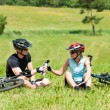 Sport mountain biking couple relax sunny meadows - Photo