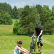 Sport mountain biking couple relax in meadows — Stock Photo #6138554