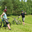 Royalty-Free Stock Photo: Sport mountain biking couple greeting in meadows