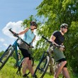 Sport mountain biking couple relax in meadows — Stock Photo #6138578