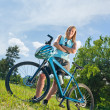 Sport mountain biking girl relax in meadows — Stock Photo #6138586