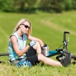 Sport mountain biking girl relax in meadows — Stock Photo #6138590