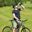 Sportive man mountain biking relax sunny meadows — Stock Photo #6138612