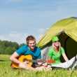 Camping couple playing guitar by tent countryside — Stock Photo