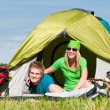 Camping couple lying inside tent summer countryside — Stock Photo