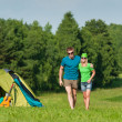 Young camping couple hugging in summer countryside — Stock Photo