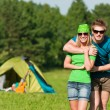 Young camping couple hugging in summer countryside — Stock Photo #6138685