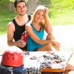 Young couple relax sunny terrace climbing gear — Stock Photo