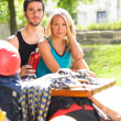 Stockfoto: Young couple relax sunny terrace climbing gear