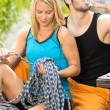 Active young couple climbing gear relax terrace — Stockfoto