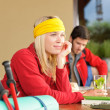 Tramping young couple relax by wooden table — Stock Photo #6138738