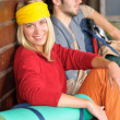 Stock Photo: Tramping young couple backpack relax by cottage