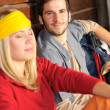 Tramping young couple backpack relax by cottage - Stock Photo