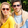 Sportive young couple portrait wear sunglasses sunny — Stock Photo