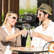 Restaurant terrace elegant couple drink sunny day — Stock Photo #6138776