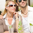 Restaurant terrace elegant couple drink sunny day — Stock Photo #6138781