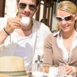 Restaurant terrace elegant couple  drink coffee - Stockfoto