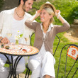 Restaurant terrace elegant couple romantic happy - Stock Photo