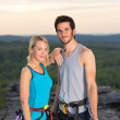 Rock climbing active couple on top sunset — Stock Photo